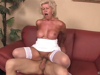 Mature granny Effie gives a titjob and rides her younger darling