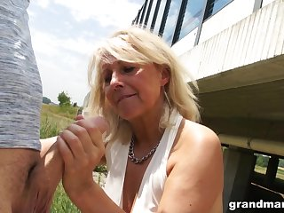 Slutty granny gives a blowjob in public and shows wet white panties